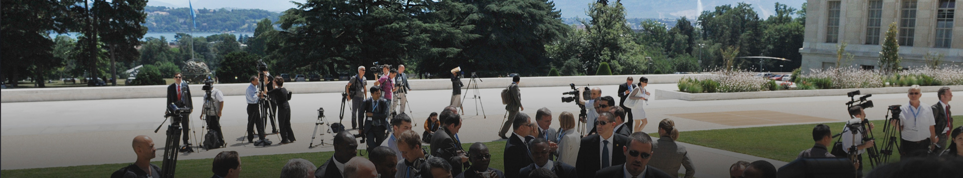 Journalists and videographers muster on the Palais des Nations plaza.